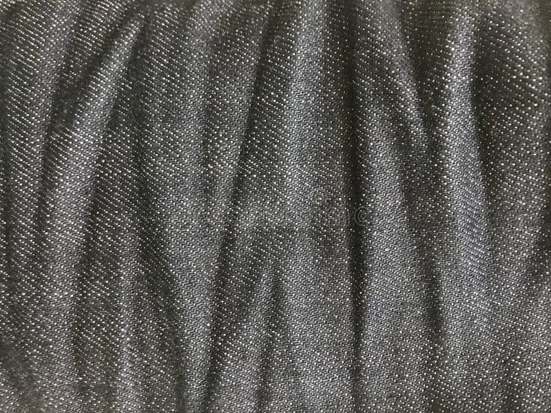 Arrugue en el fondo de los vaqueros, textura azul abstracta de la tela de la mezclilla fotos de archivo libres de regalías