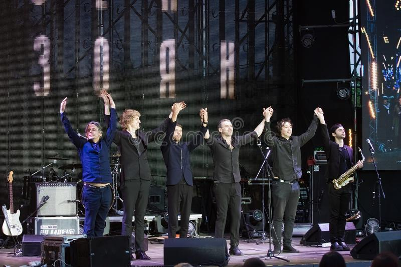 Arsen Mirzoyan and his rock band bowing after concert at Roshen fountain opening, Vinnytsia, Ukraine, 29.04.2017, editorial photo. Arsen Mirzoyan and his rock royalty free stock photos
