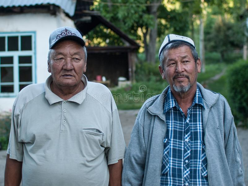 Two men with traditional hats, Kyrgyzstan stock photography