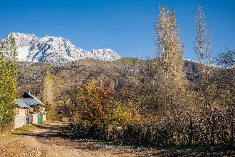 ARSLANBOB, KYRGYZSTAN: View of Arslanbob village in southern Kyrgyzstan, with mountains in the background during autumn. royalty free stock photos