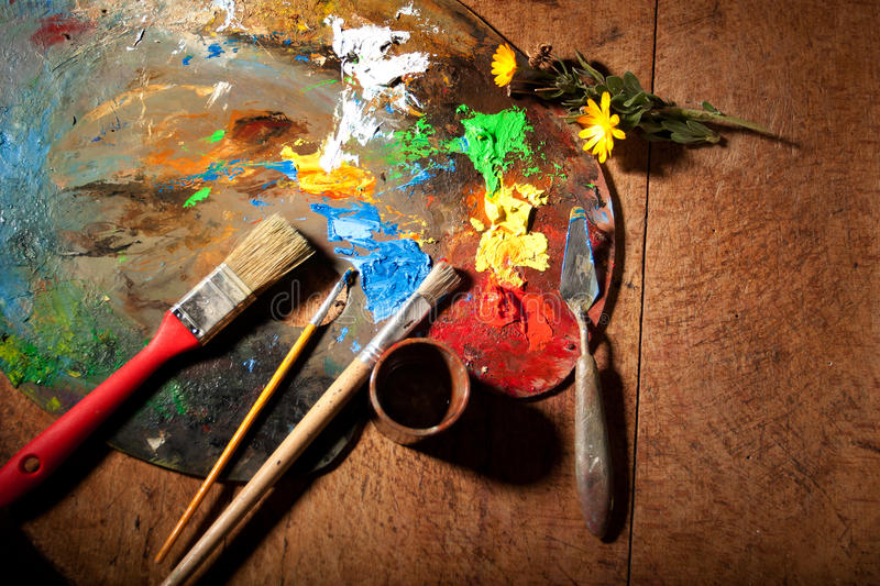 Art. Paint brushes on wooden palette stock photography