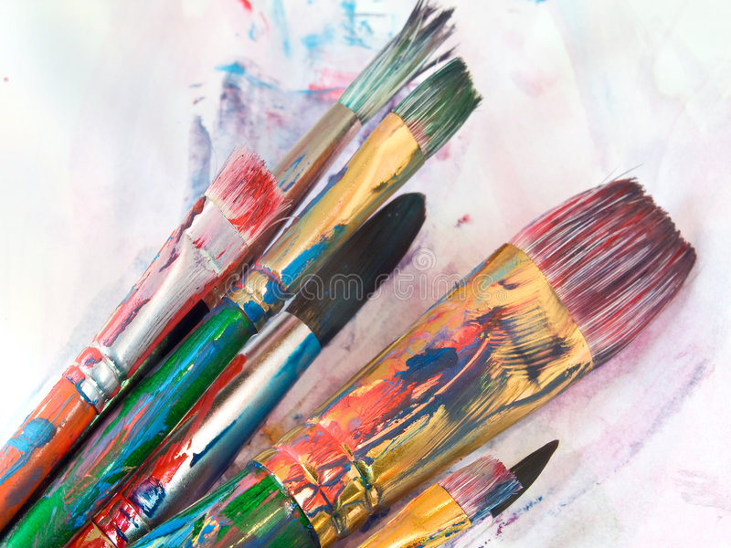Art. Paint brushes on art paper stock photo