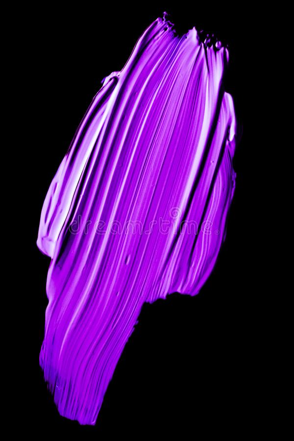 Purple neon paint brush stroke texture isolated on black background. Art abstract, cosmetic product and hand painted design concept - Purple neon paint brush royalty free stock images