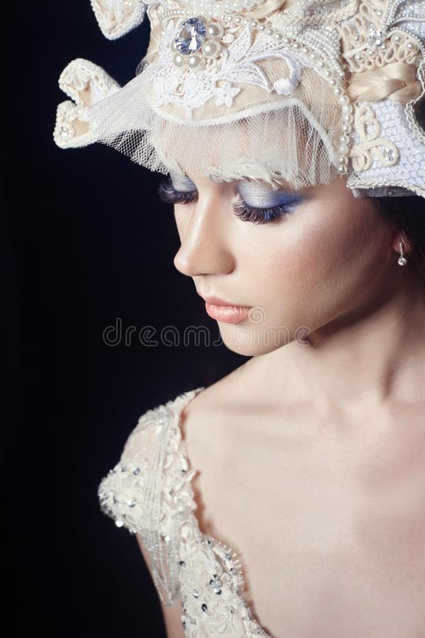Art beauty girl portrait, eyelashes and makeup. Pure skin, skin care and eyelashes. Woman in Russian national dress and tiara royalty free stock photos