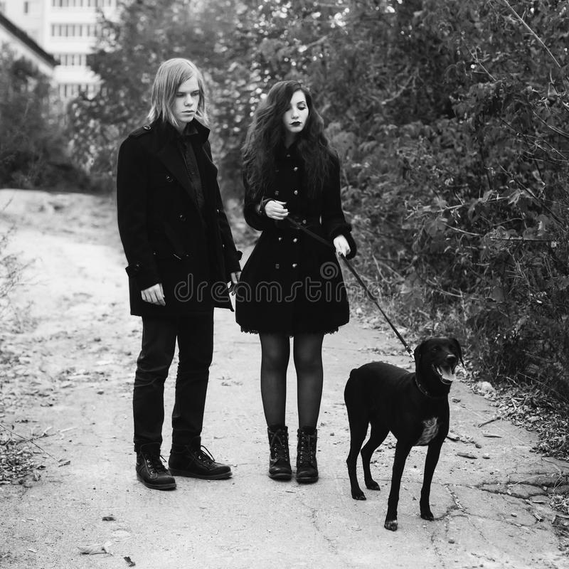 Art black and white photography. Black and white art monochrome photography. Informal guy with long hair and a women with long curly hair in a black coat royalty free stock photos