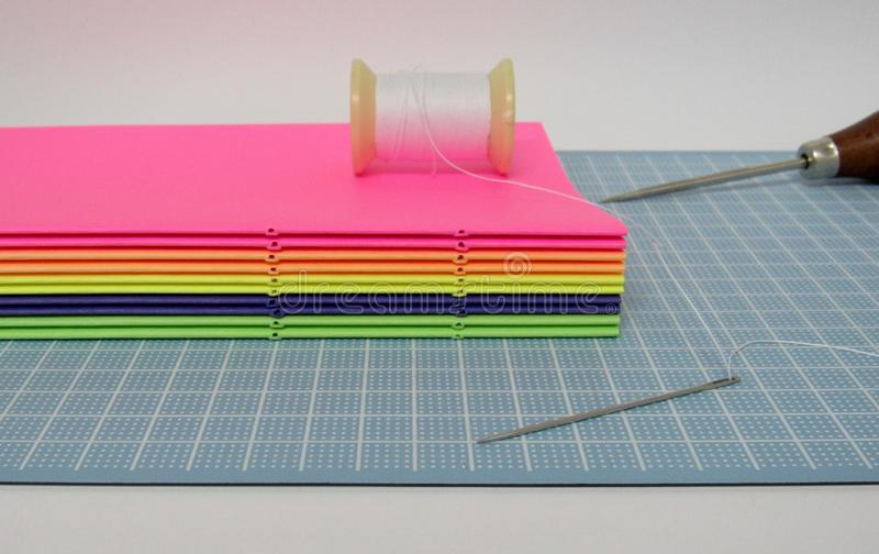 The art of bookbinding. The sewing process in the art of bookbinding stock images