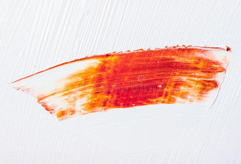 Artistic abstract texture background, orange acrylic paint brush stroke, textured ink oil splash as print backdrop for luxury stock photo