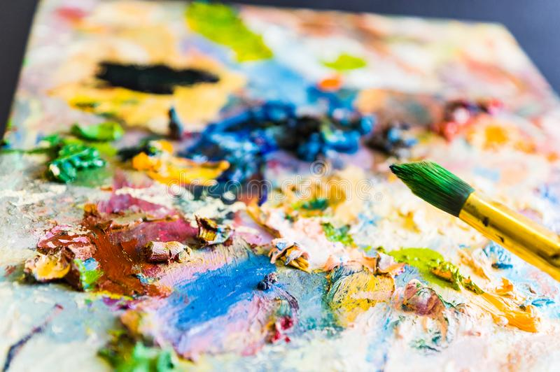 Art brush and palette with oil paints. Soft focus royalty free stock images