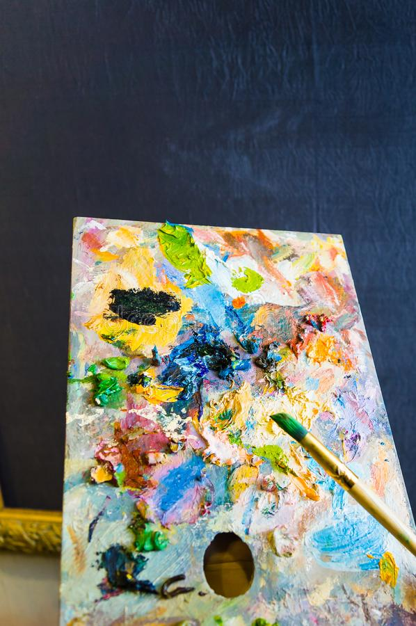 Art brush and palette with oil paints royalty free stock photo