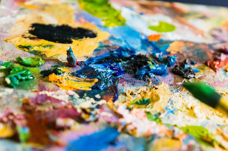 Art brush and palette with oil paints. Soft focus stock photos