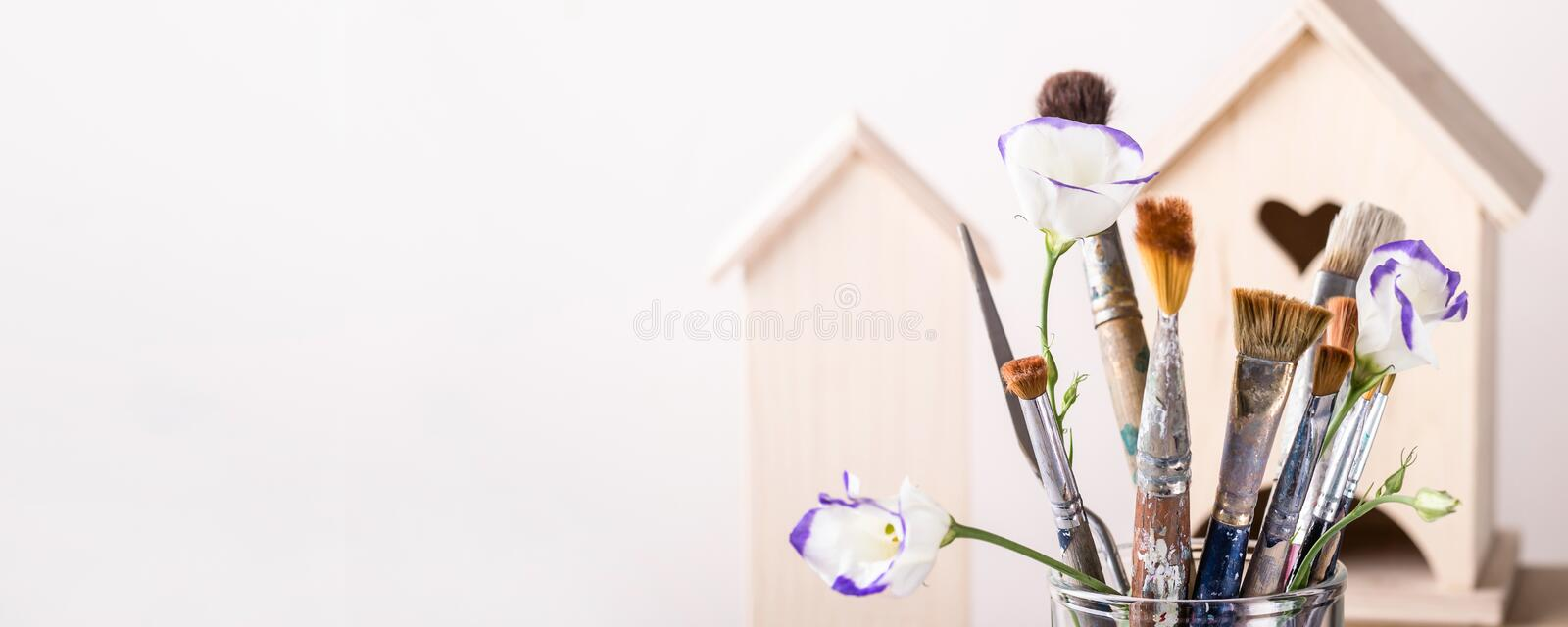 Art Brush Set and wooden house for decoration on white background. Banner format.  stock photo