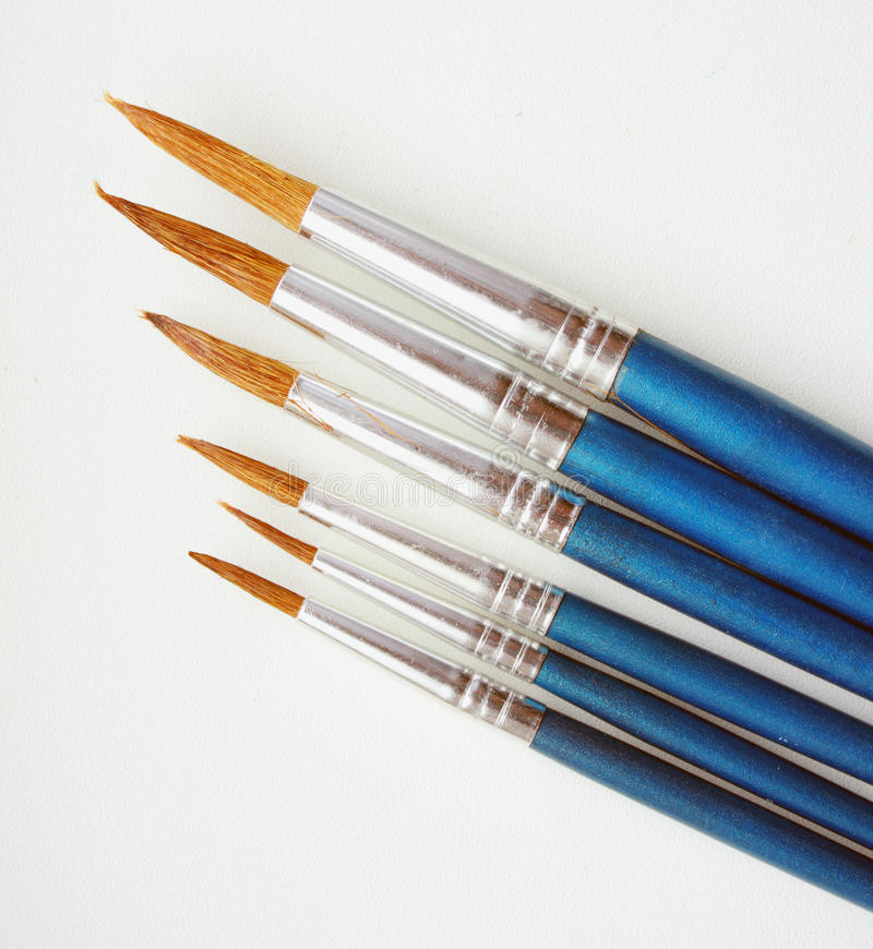 Art brushes. Lie on a white table as it should be from small to the big stock photos