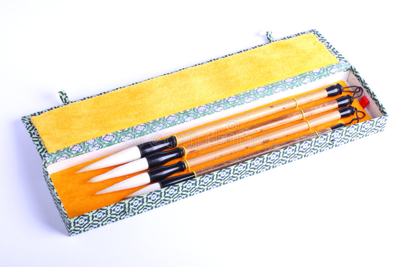 Art brushes in case. Set of Chinese art brushes in an open case royalty free stock photography
