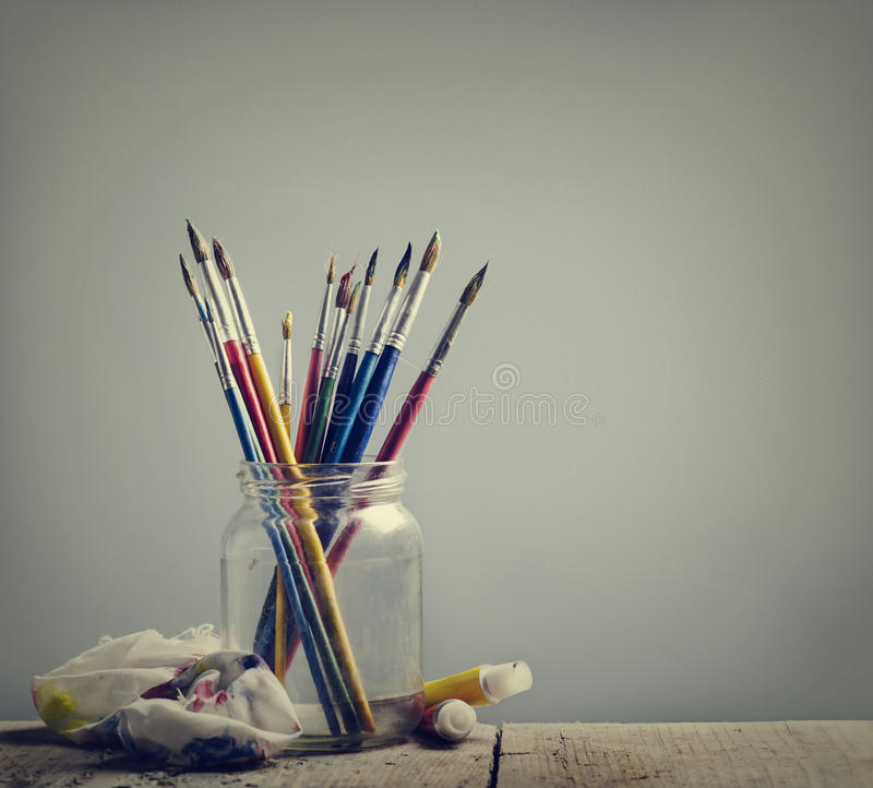 Art Brushes. And colors on wooden table royalty free stock image
