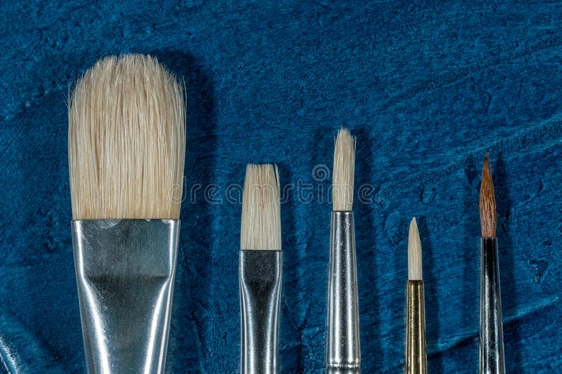 Art brushes for painting. With oil paints stock photos