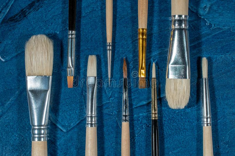 Art brushes for painting. With oil paints stock image