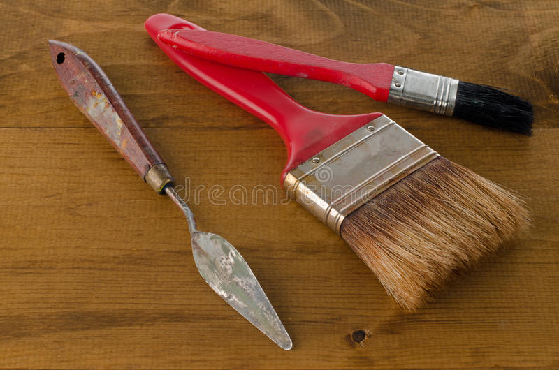 Art brushes and spatula. Closeup of clean used Art brushes and spatula on wooden background stock images