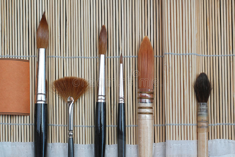 Art Brushes. Various artistic paint brushes for fine art royalty free stock photo