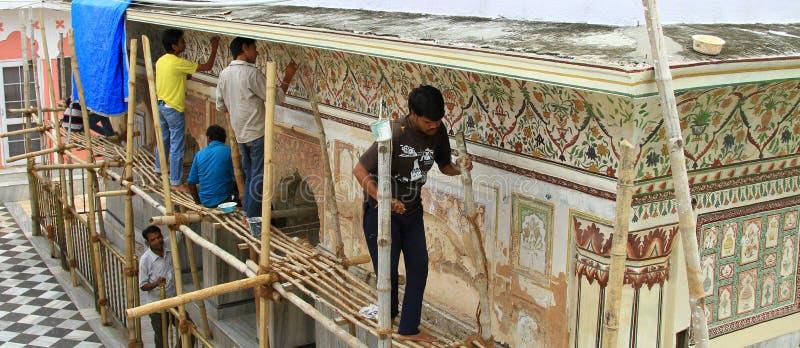 Art of carving. Workers doing carving on the wall of Mata Manasa Devi temple at panchkula, haryana India stock photos