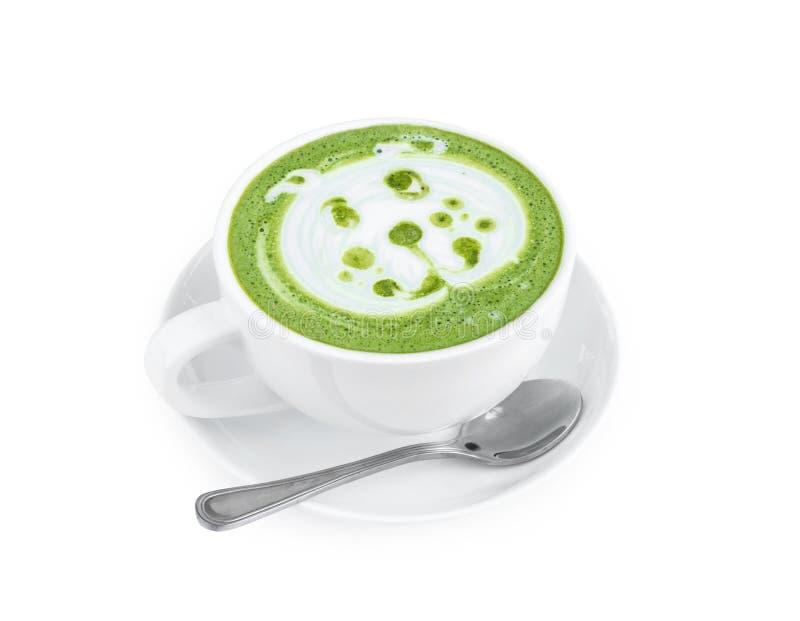 Art chaud de latte de matcha avec la bande dessinée mignonne de visage de chien sur la table en verre o photographie stock libre de droits