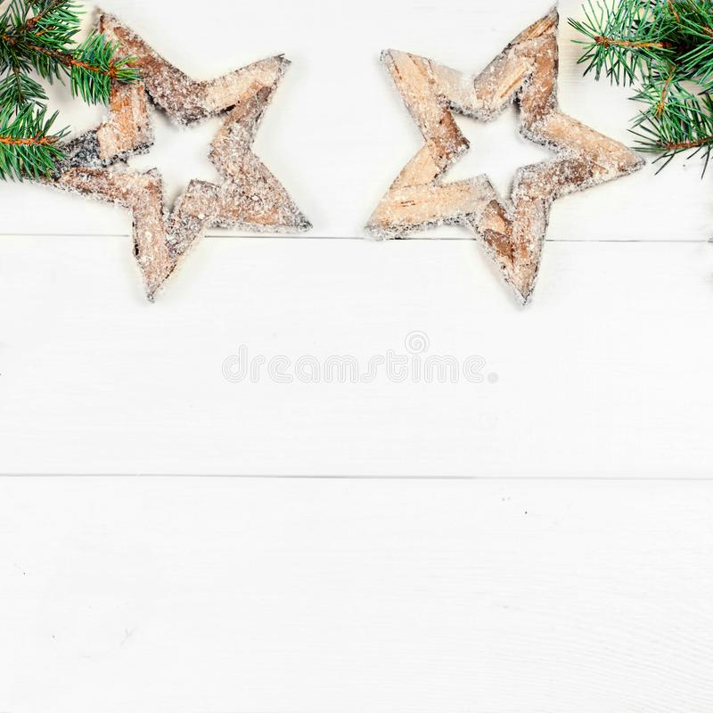 Art Christmas tree decoration on white wooden background with wooden stars and copy space for text. Vintage Christmas royalty free stock photo
