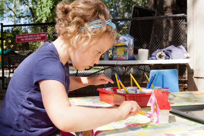 Art Class. Cute little baby girl having fun painting at art class royalty free stock photo