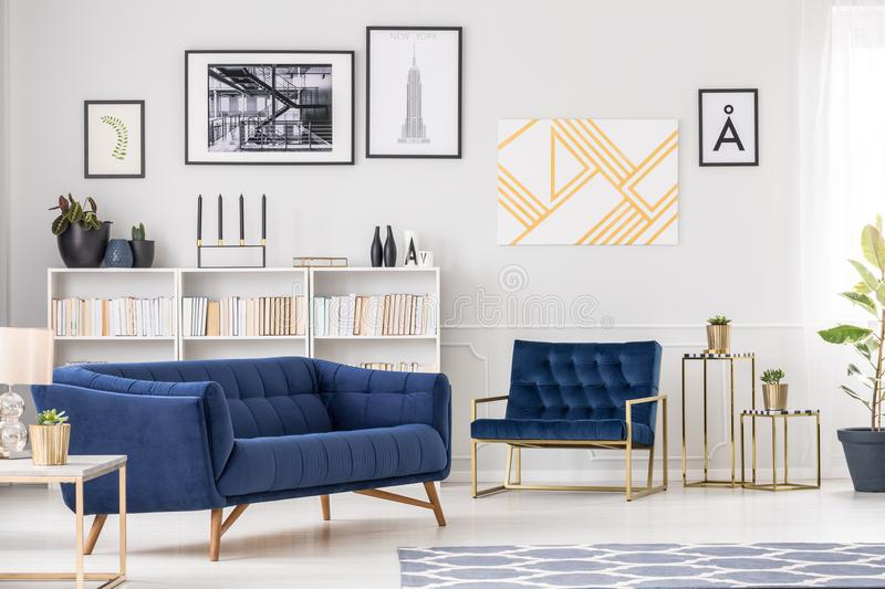 Art collection and sofa stock images