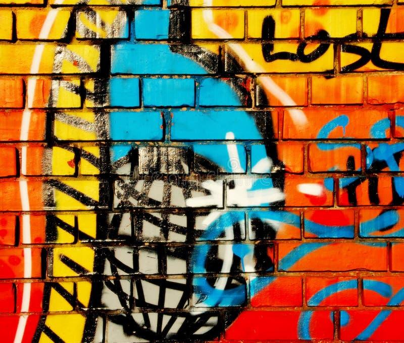 Art coloré de jet de graffiti sur un mur de brickstone photos stock