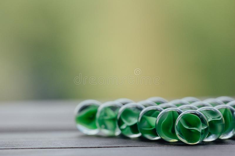 Artistic composition of marbles clear glass balls. Art composition of transparent glass balls. Marbles. Children`s games. Marble. Glass marbles decoration color royalty free stock image