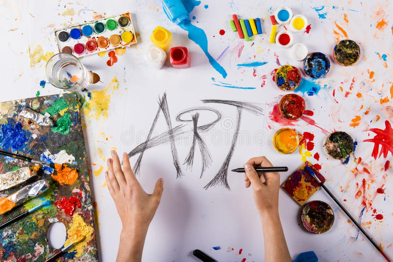 Art concept. Creative art concept with colorful paints over white paper stock photo