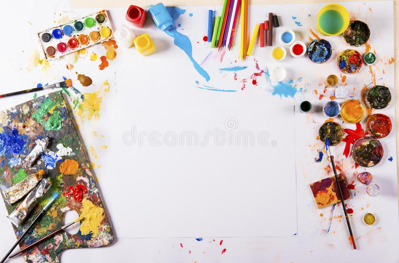 Art concept. Creative art concept with colorful paints over white paper royalty free stock photo