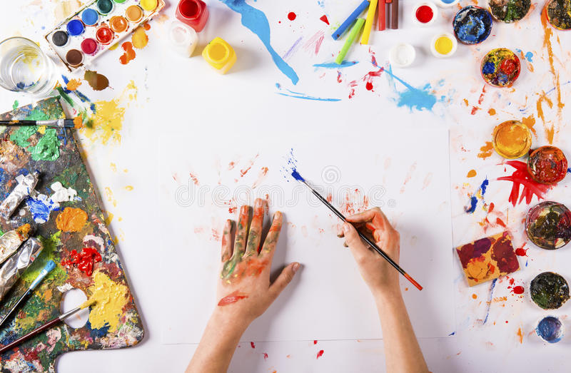 Art concept. Creative art concept with colorful paints over white paper stock photography