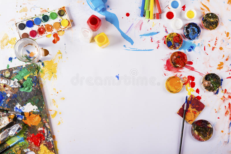 Art concept. Creative art concept with colorful paints over white paper stock images
