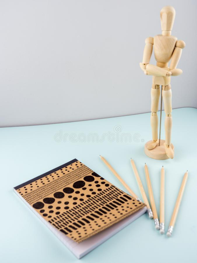 Art concept with sketchbook, wooden manikin, pensiles royalty free stock photos