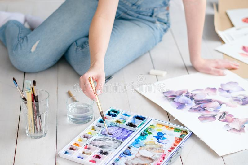 Art craft painter work woman mix watercolors draw stock image
