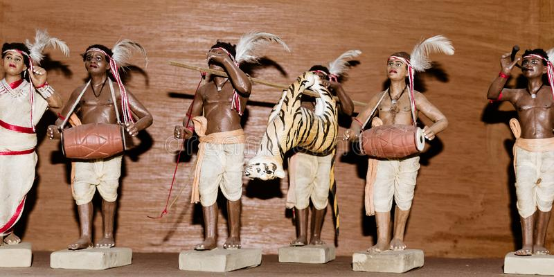 Art and craft product depicting Royal Bengal Tiger Hunting festival by tribal village people of ancient Santals tribe india. A stock photos