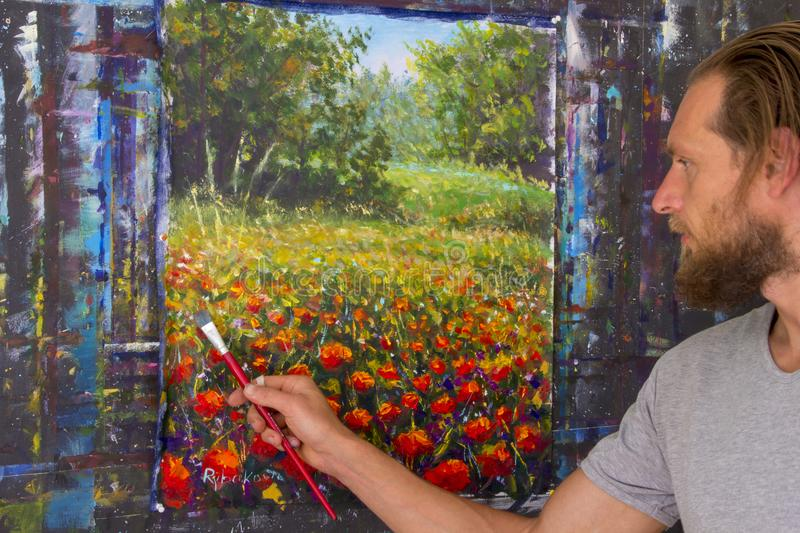 Art creative process. Artist create painting on canvas. Artist create Italian tuscany red poppies flowers in forest landscape painting on canvas stock photo
