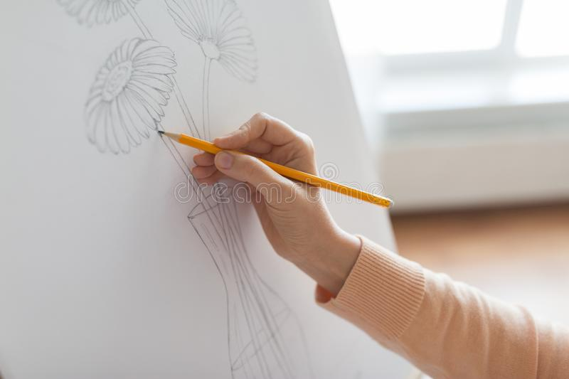 Artist with pencil drawing picture at art studio stock images