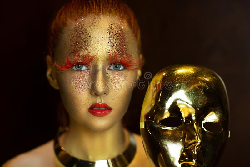Art d'or de visage photos stock