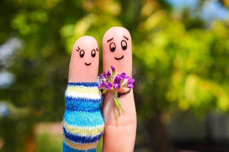 Art de doigt des couples heureux image stock