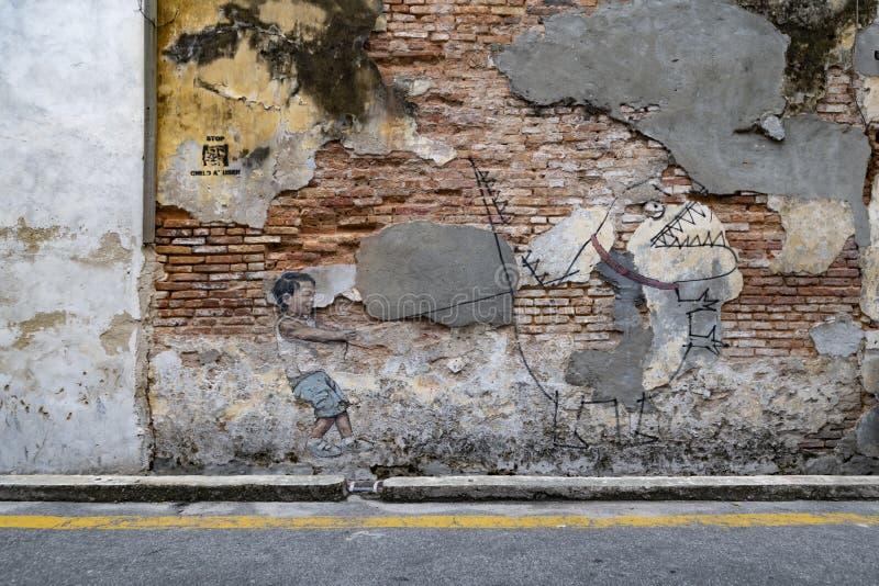 Art de rue de Penang sur le mur photographie stock libre de droits