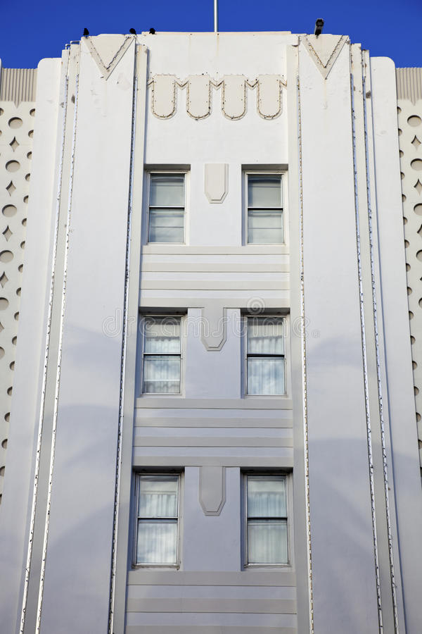 Art deco building with the shadow of palm tree royalty free stock photo