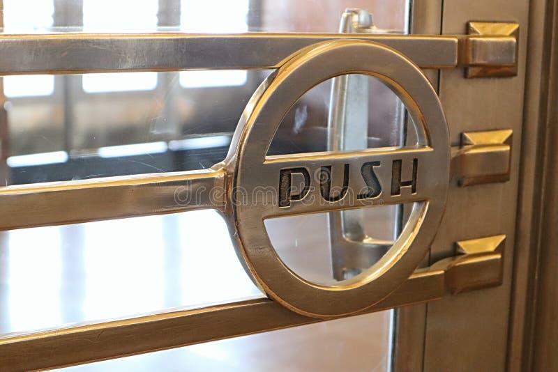 Art deco door handle with push written on it stock photo