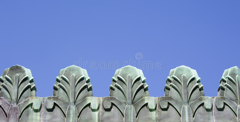 Art deco edges. Against a blue sky royalty free stock images