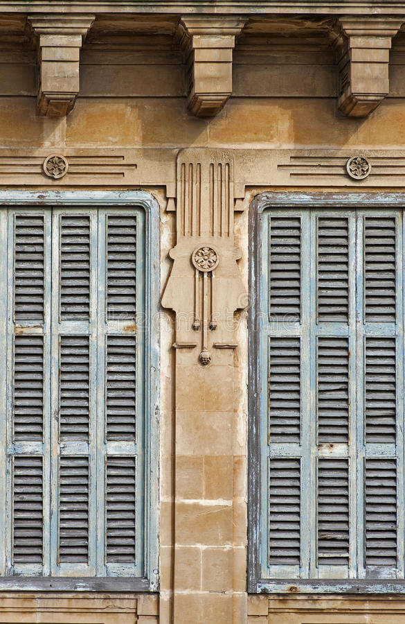 Art deco ornament. Window with blue shutters and frames adorned in the art deco styles stock photography
