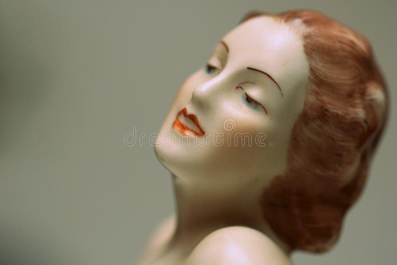 Art deco porcelain flapper girl statue portrait detail. Antique Czechoslovakian hand painted porcelain art deco nude face detail, typical 1920s, 1930s make up stock images
