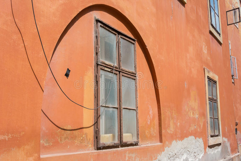 Art deco style wall arch terracotta colored. Art deco style arch with terracotta coloured wall stock photography