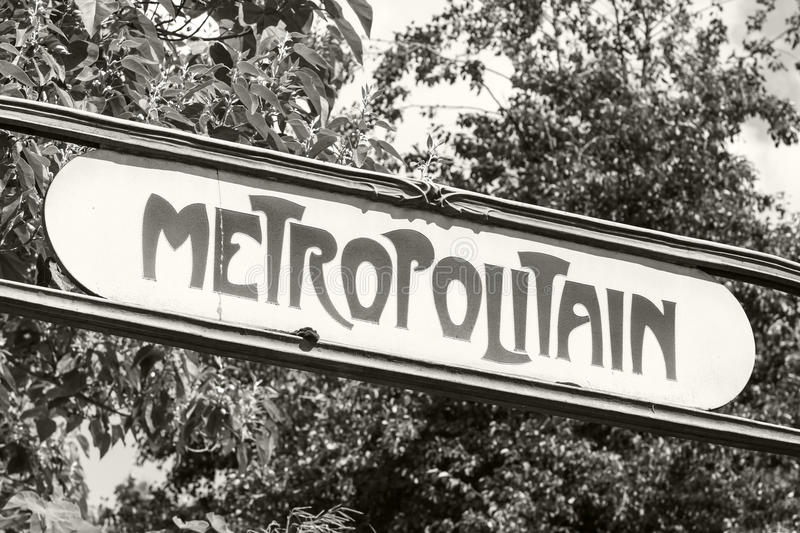 Art-Deco styled Street sign at the entrance to the Paris Metro. Retro stylized monochrome photo royalty free stock photo