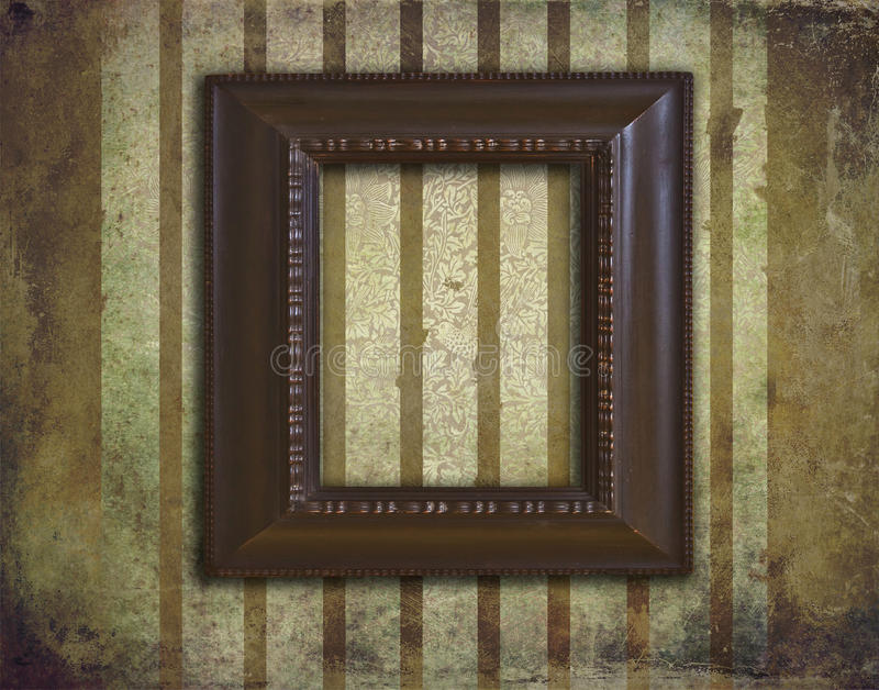 Art deco wooden frame on grunge and faded wallpaper royalty free stock images