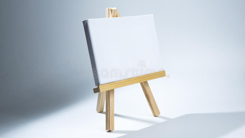 Art Easel Horizontal Canvas. Isolated Wooden Art Easel with blank horizontal canvas royalty free stock photos